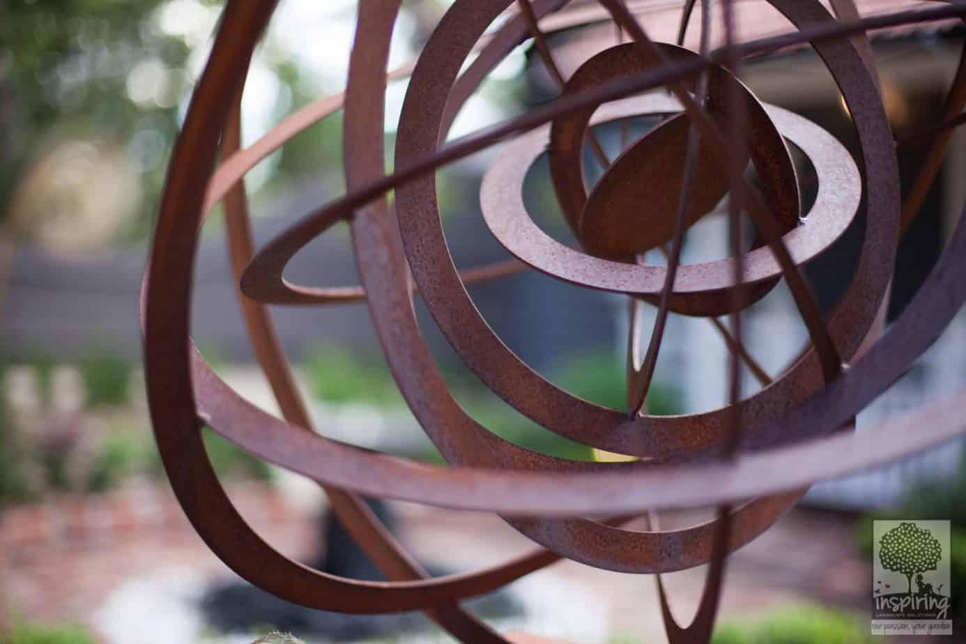Corten spherical ring garden sculpture in Blackburn landscape design