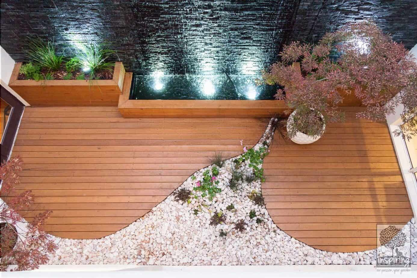 View of courtyard with wall to wall water feature from the upstairs bedrooms