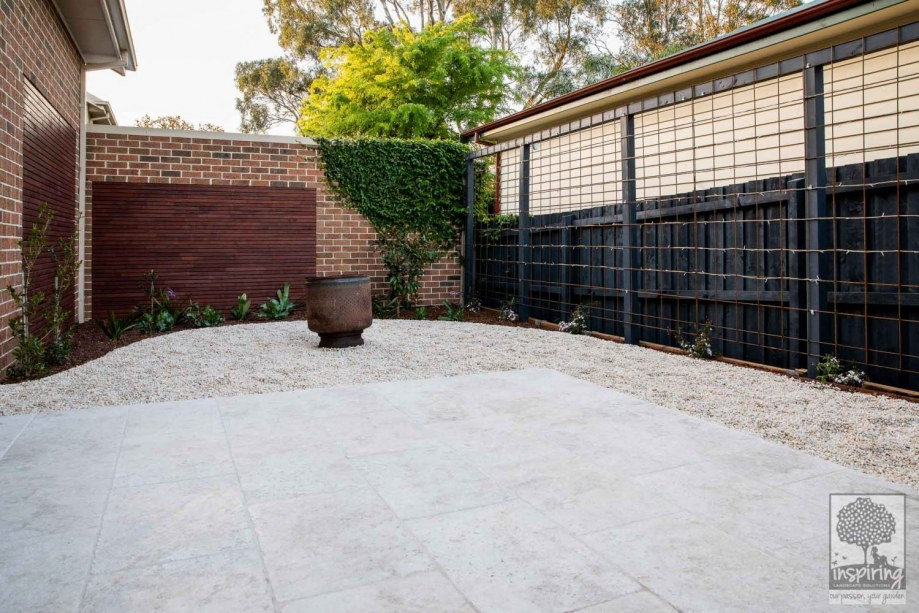 Travertine paving in outdoor area in Surrey Hills landscape design