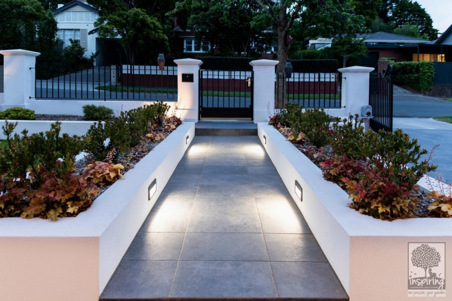 Front entrance garden beds of a new build in Camberwell lit up at night