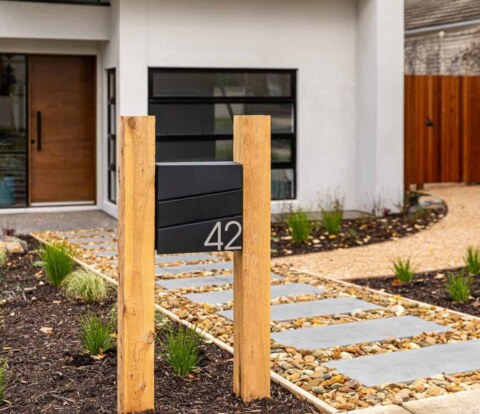 View of front entry stepper path from the street in Burwood landscape design by Parveen Dhaliwa