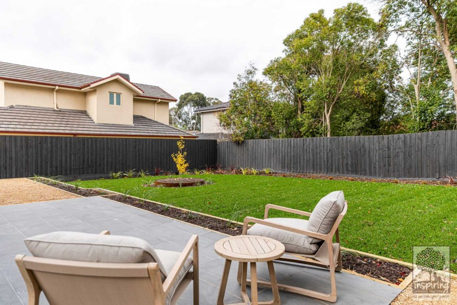 View of garden from outdoor patio seating in Burwood landscape design by Inspiring Landscape Solutions