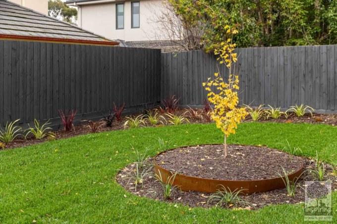 Backyard grassed area in Burwood landscape design by Inspiring Landscape Solutions