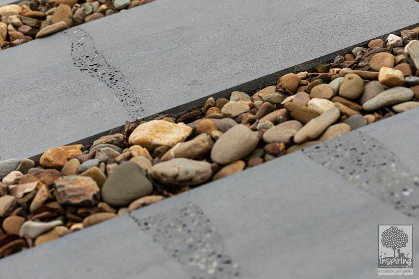 Close up of bluestone paving and oversized pebbles in Burwood landscape design by Parveen Dhaliwal