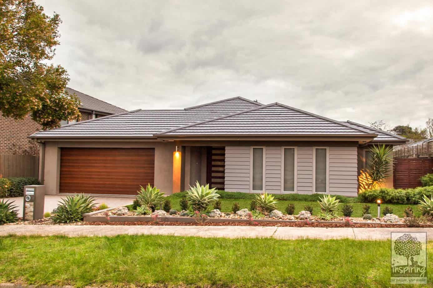 Ashburton front landscape design with large lawn area surrounded by mainly succulents