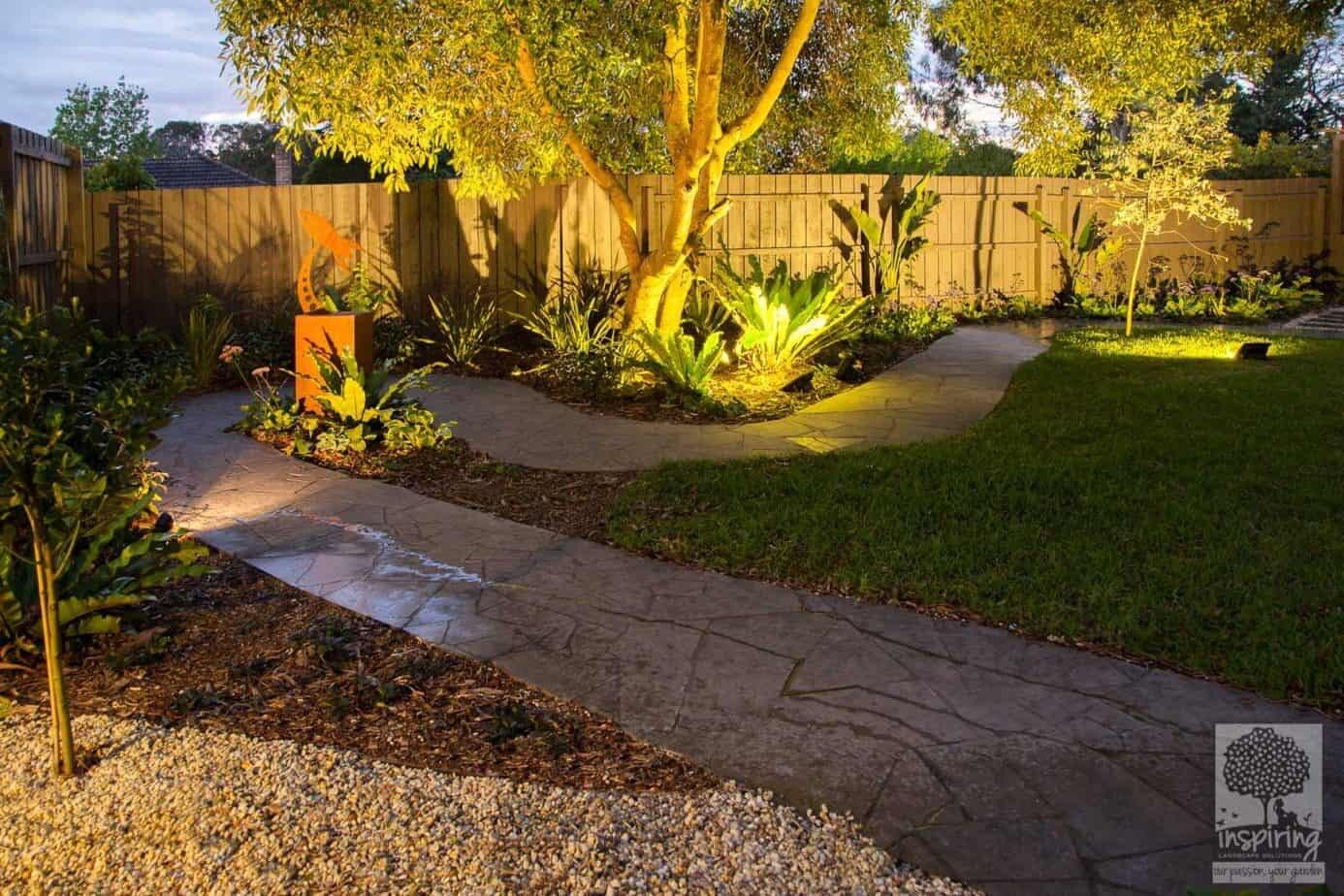 Crazy paved path in Blackburn garden design with rocket metal sculpture