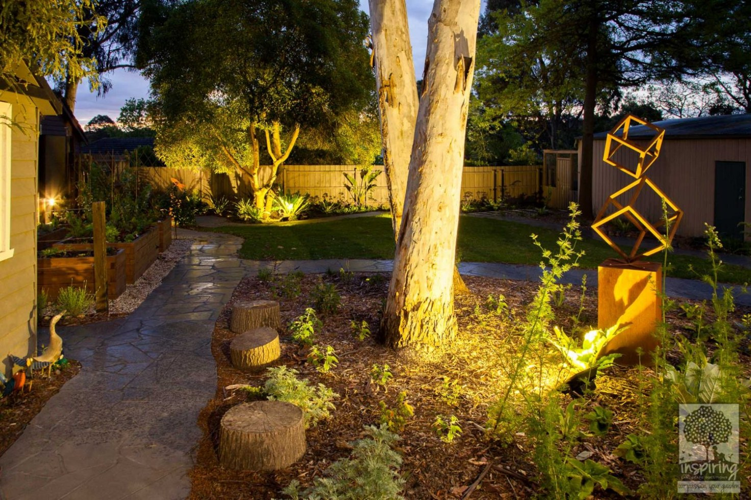 View of Blackburn backyard garden lit up at night