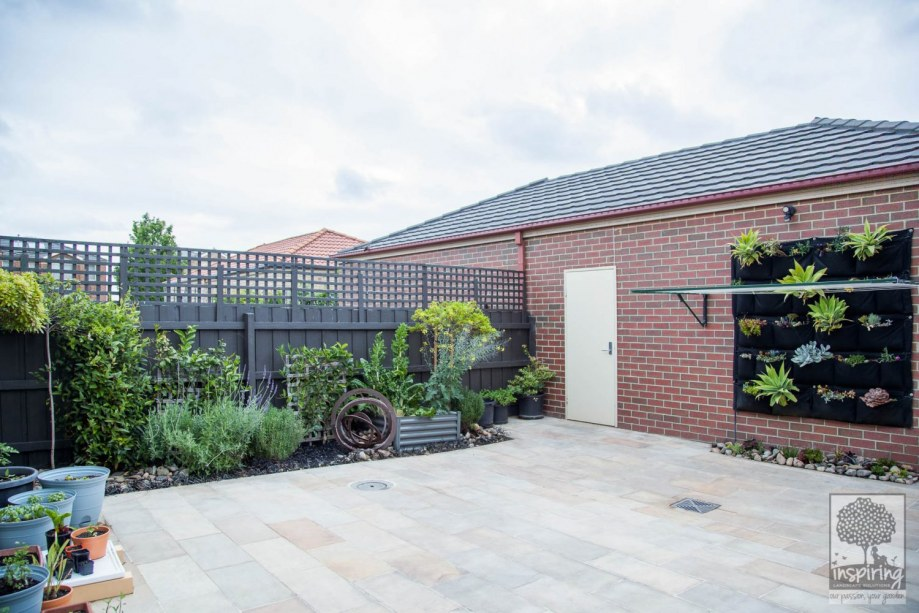 Bundoora garden design with sandstone paving and edible planting by Parveen Dhaliwal