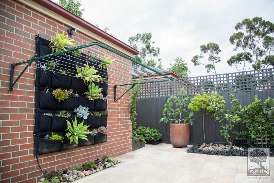 Bundoora garden design with sandstone paving and edible planting