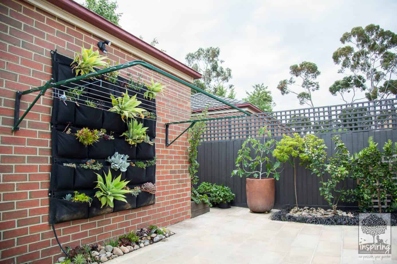 Bundoora garden design with sandstone paving and edible planting