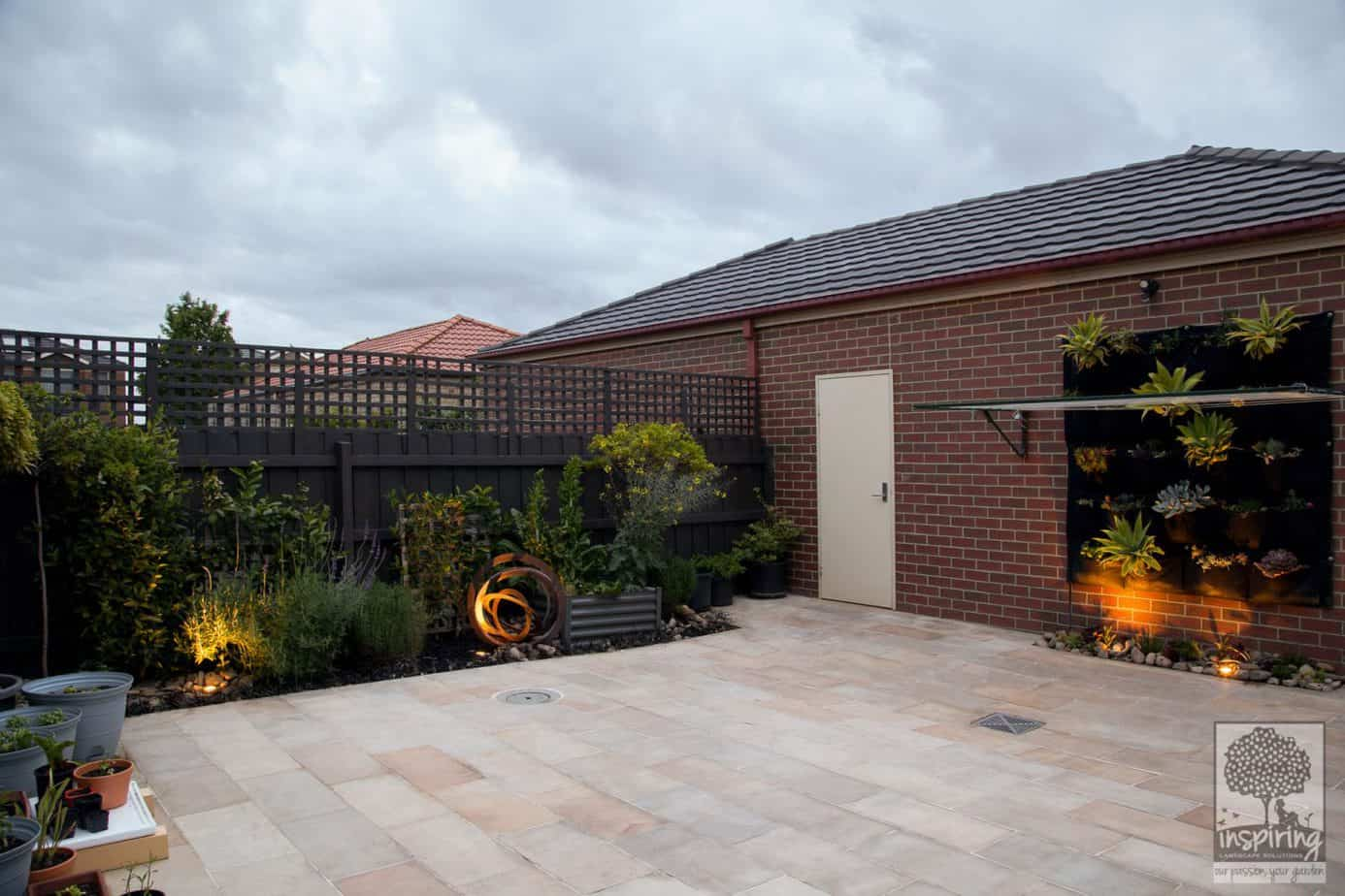 Courtyard garden design with sandstone paving and edible planting