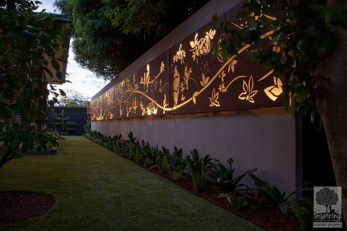 13 meter metal garden feature used in Glen Waverley garden design lit at night