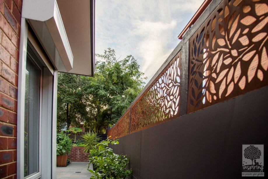 Beautiful corten fence topping used in Kew garden design by Parveen Dhaliwal