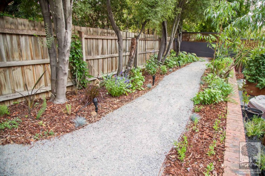 Rear garden path with edibles and perennial planting in Kew design