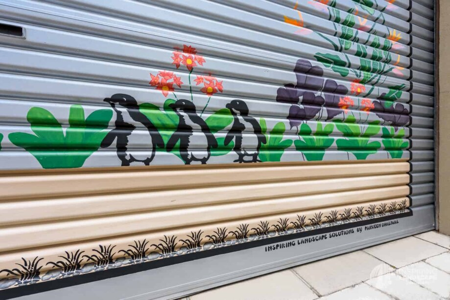 Penguin and bird of paradise mural in Hawthorn garden design by Inspiring Landscape Solutions
