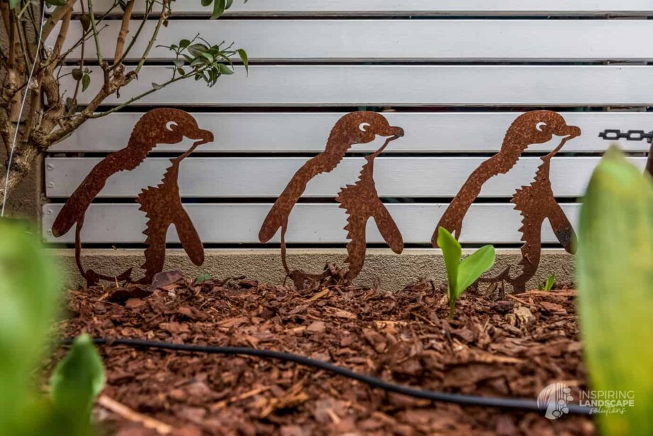 Penguin metal garden stakes in Hawthorn garden design by Inspiring Landscape Solutions