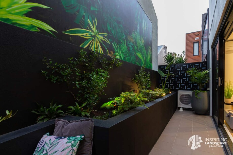 Tropical garden design in Richmond courtyard with feature mural